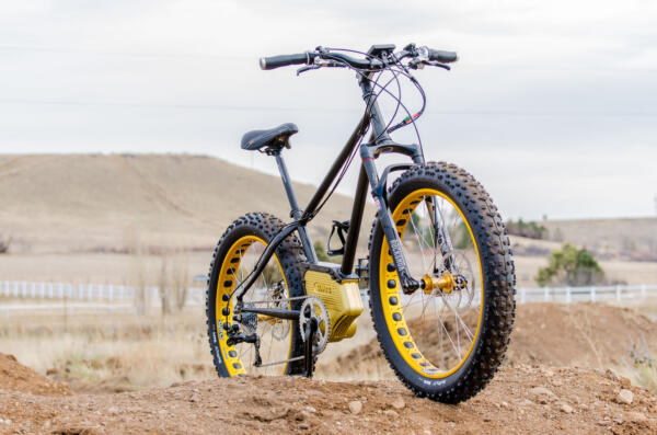 SIMBB Fat Tire E-Bike on top of a dirt jump