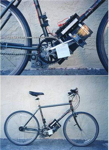 The first Optibike Prototype in 1998, shown with its lead acid battery pack and mid drive motor