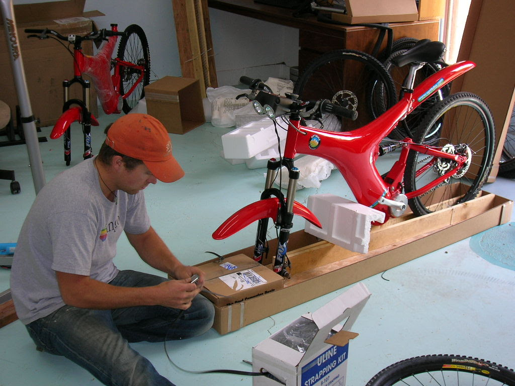 Optibike employee Craig finishing up the final touches on the First Optibike Produced in 2006