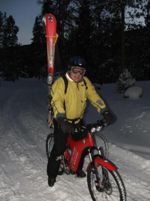 Jeff Baum on His Optibike in Breckenridge, CO, where he rides it through the snow to work with skis strapped to his back