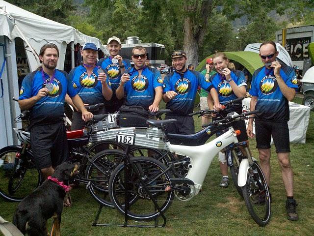 A group of Optibike Riders took 1st to 7th places in the Pikes Peak Hill Climb Event in 2011, shown here after the race with their Optibikes.