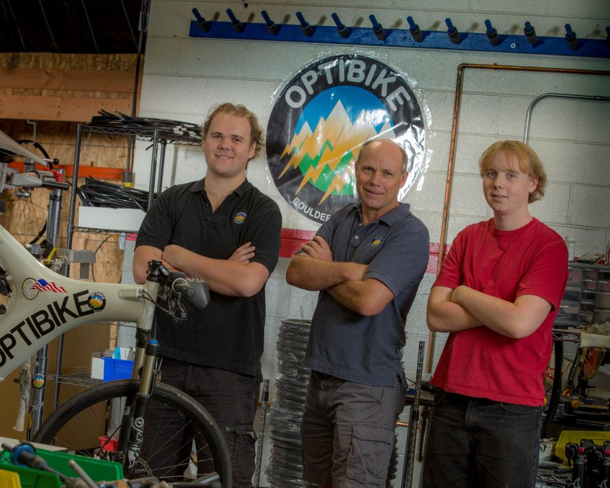 Photo of Jim Turner, Nicholas Turner, and Austen Turner in the Optibike Shop in Boulder, CO