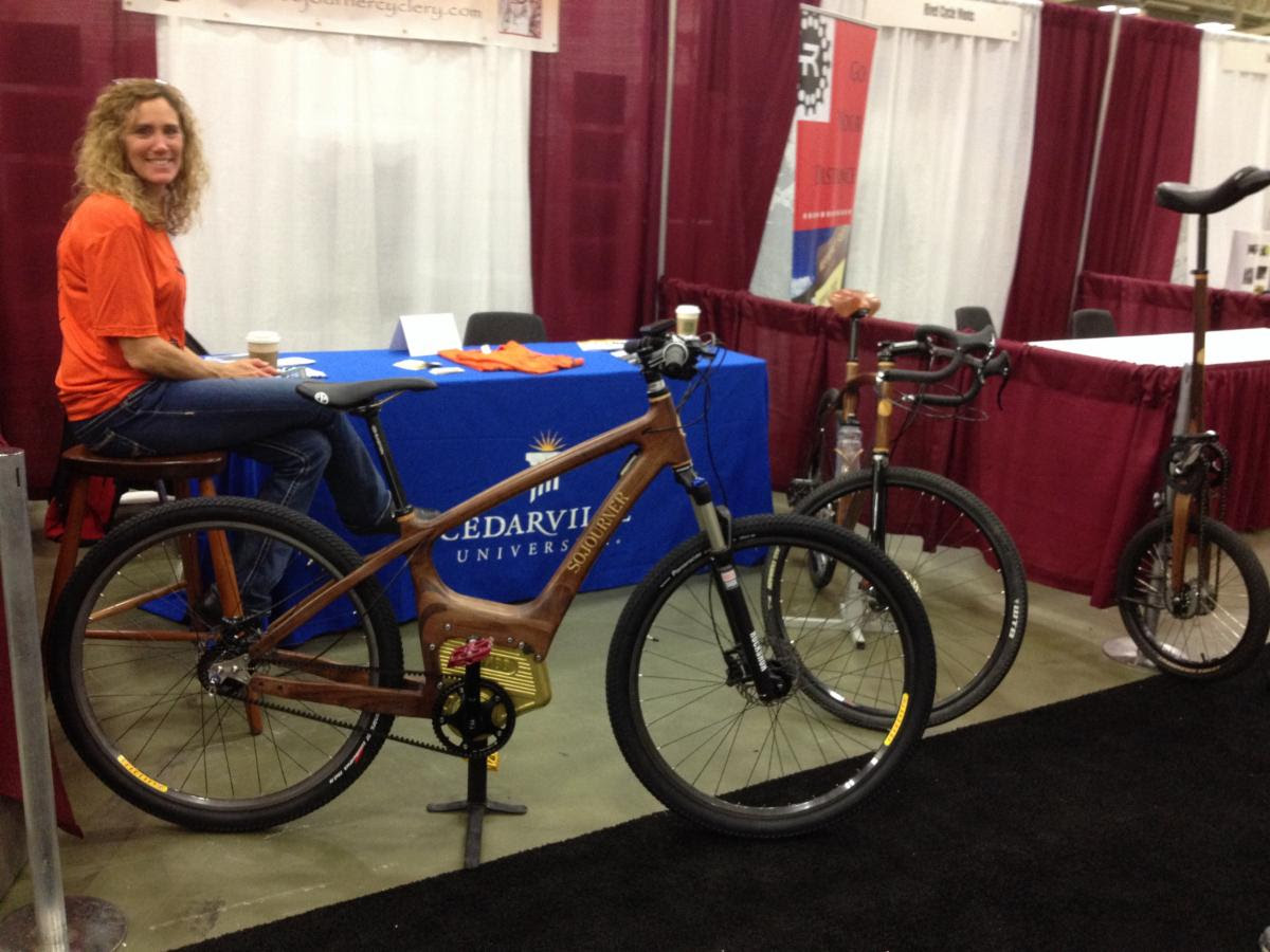Optibike SIMBB Motor in a hand built wooden bike frame, displayed at The National Hand Built Bicycle Show, and built by Professor Jay Kinsinger at Cederville University