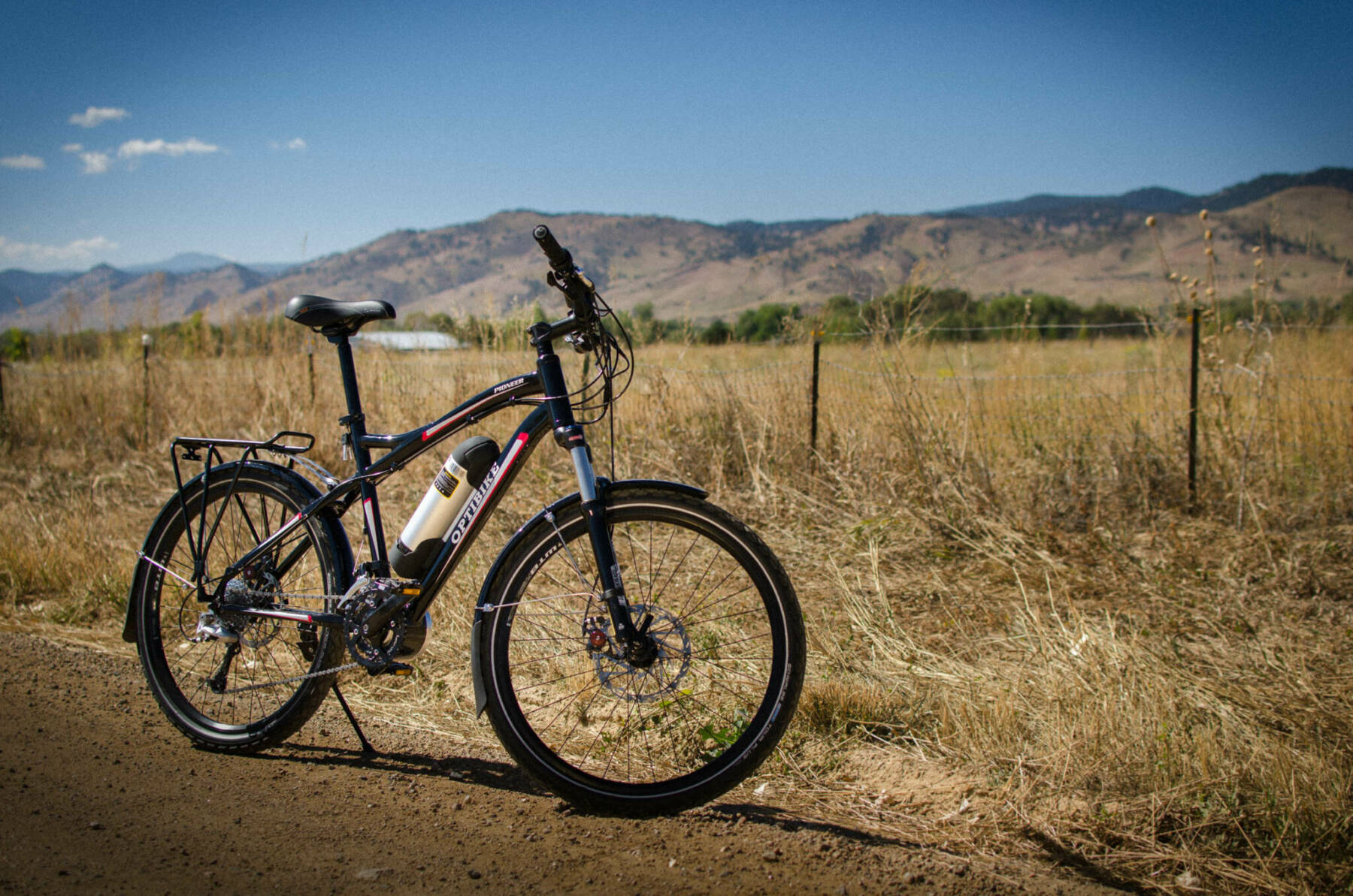 Optibike pioneer allroad with mountains in the background