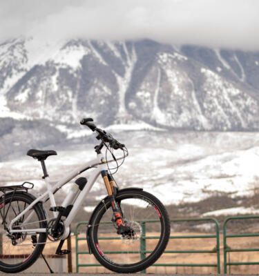 Pioneer Allroad Limited with a backdrop of snowy muntains