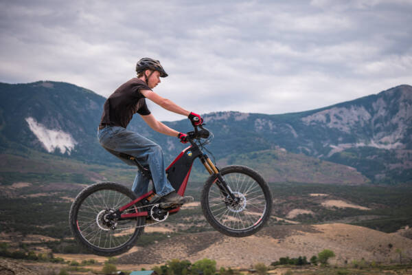 The Optibike R15C has robust offroad suspension to soak up bumps