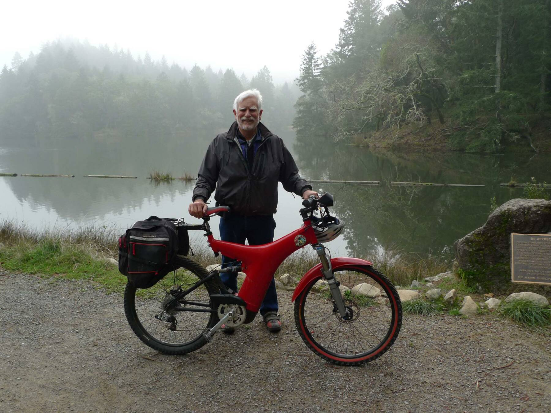 Rodger Jacobsen with his Optibike R8 in front of a foggy lake